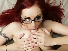 Big boobs... nice ass... teachers glasses. Nuff said. Ok.. flame red hair and tatoos to boot. But man.. can she fuck.